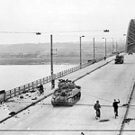 300px-British_XXX_Corps_cross_the_road_bridge_at_Nijmegen_